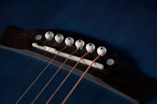 Guitar Neck With Strings Close-up On A Black Wooden Background