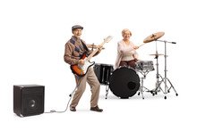 Elderly Woman Playing Drums And Man Playing An Electric Guitar