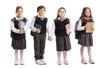 Three schoolgirls and one schoolboy wearing school uniforms
