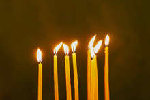 Thin Yellow Candles On Green B...