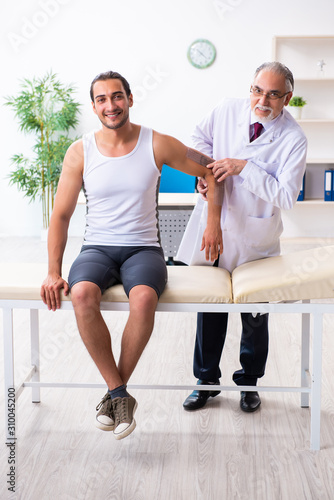 Young male patient visiting experienced doctor - 310045200