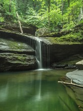 Waterfall In The Cloudland Canyon State Park Surrounded By Greenery And Stones