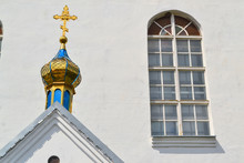Orthodox Church In Belarus, Details Of Bell Tower With Snow White Wall And Arched Stained Glass Window. Close Up Image