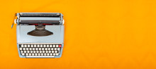 Old Vintage Style Typewriter Top View Photo On Yellow Background