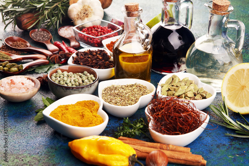 Fototapeta Spices and herbs on table. Food and cuisine ingredients with oil and vinegar obraz