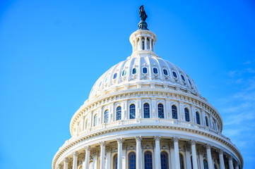 East side of the US Capital dome with blue sky background