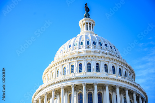 Leinwand Poster East side of the US Capital dome with blue sky background