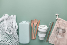 Set Of Reusable Eco Friendly Products . Zero Waste Concept. Cotton Bags, Bamboo Cutlery, Straw, Reusable Cup And Lunch Box