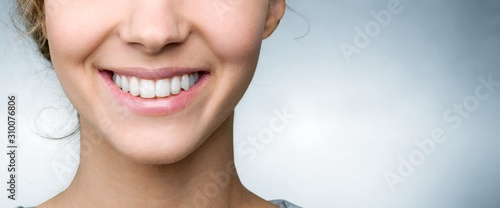 Fototapeta Beautiful smile of young woman with healthy white teeth