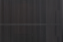 Metal Wall With Vertical Gray Bars