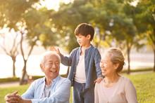 Asian Grandparents Enjoying Go...
