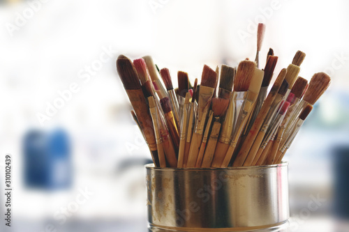 Artist Paint Brushes. Used kit paint brushes in can. Close-up. Great art background.