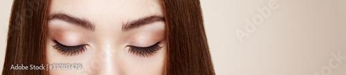 Female Eye with Extreme Long False Eyelashes. Eyelash Extensions. Makeup, Cos...