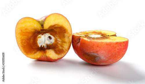 badly overripe apple with moldy core on white background Tapéta, Fotótapéta