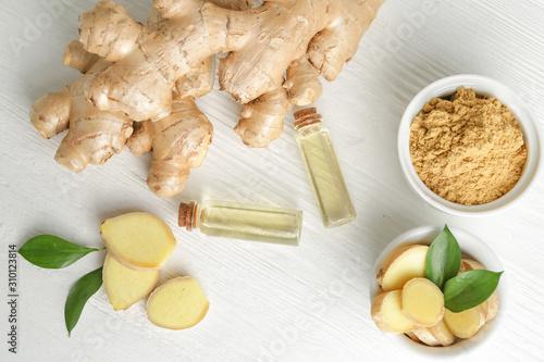 Fototapeta Bottles with ginger essential oil on wooden table obraz