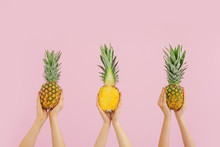 Hands With Juicy Pineapples On...