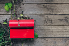 Red Mail Box On Wooden Wall Ba...