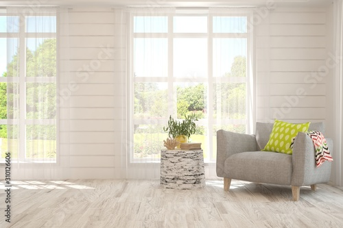Fototapeta Mock up of stylish room in white color with armchair and green landscape in window. Scandinavian interior design. 3D illustration obraz na płótnie