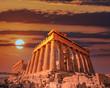 Parthenon ancient temple facade under dramatic fiery sky, Athens acropolis Greece