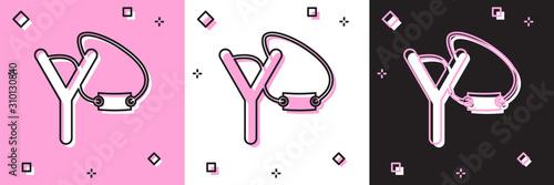 Set Slingshot icon isolated on pink and white, black background Fototapet
