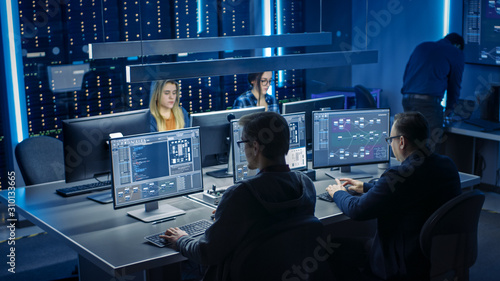 Fotografia Team of IT Programers Working on Desktop Computers in Data Center System Control Room