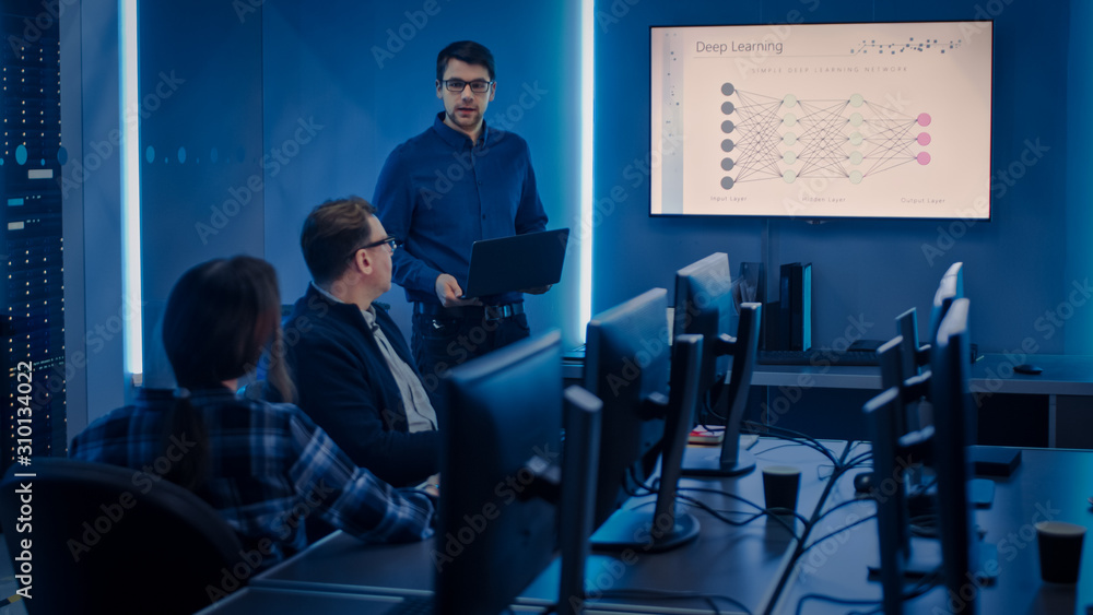 Team of Professional IT Developers Have Meeting, Speaker Talks about New Blockchain Based Software Development Shown on TV. Software Development, Deep Learning, Artificial Intelligence, Data Mining