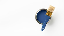Can Of Classic Blue Paint And Brush On White Background. Trendy Color Concept. Top View.