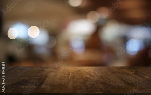 Obraz Empty dark wooden table in front of abstract blurred bokeh background of restaurant . can be used for display or montage your products.Mock up for space. - fototapety do salonu