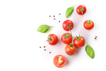 Ripe Red Cherry Tomatos  And Basil On White Background. Top View