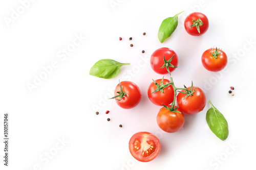 Tela Ripe red cherry tomatos  and basil on white background. Top view