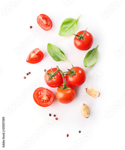 Canvastavla Ripe red cherry tomatos  and basil isolated on white background