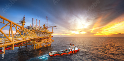 Fototapeta Rig platform and Supply vessel in the gulf obraz