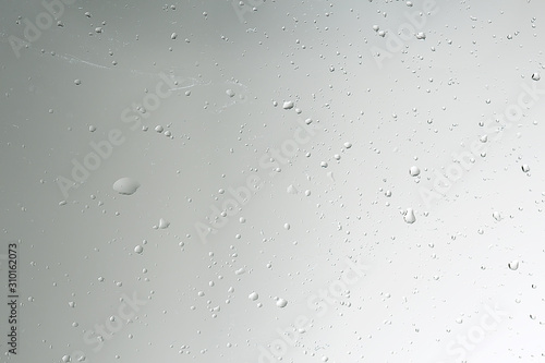 Fotografía  wet glass background condensate / abstract rain, drops texture on transparent gl