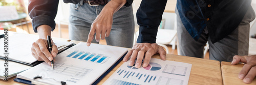 Photo Business People Meeting to analyse and discuss and brainstorming the financial report chart data in office, Financial advisor teamwork and accounting concept