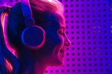 Image Of Woman Listening To Mu...