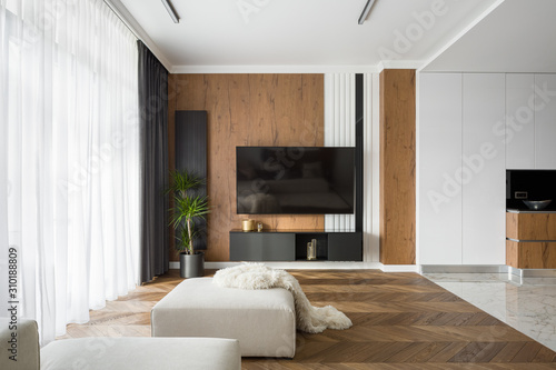 Obraz Living room with tv open to kitchen - fototapety do salonu