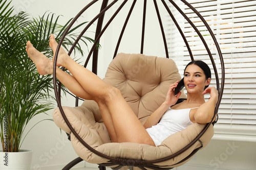 Fototapeta Beautiful young woman in white underwear talking on phone at home