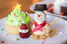 Christmas Cupcakes With Decoration. Snowman With Winter Spices For Christmas