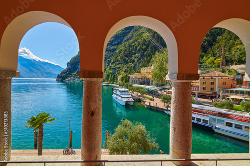 Riva del Garda,Lago di Garda ,Italy - 13 October 2019:Tourists enjoying a walk a Wallpaper Mural