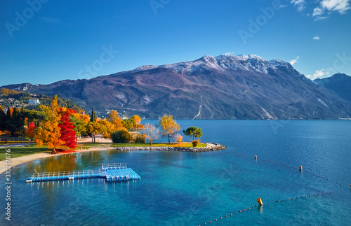 Beautiful and colorful autumn in Riva del Garda, Garda lake surrounded by mounta Canvas Print