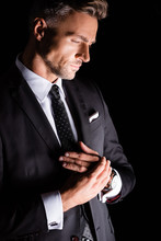 Side View Of Thoughtful Businessman Looking Down Isolated On Black