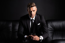 Handsome Businessman With Glas...
