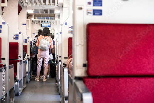 Passenger is standing in lines waiting or queuing to get out from Train in Thailand Canvas Print