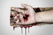 Bleeding Hand Of Jesus Christ Nailed To The Wooden Cross