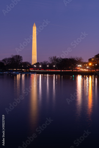 Washington Monument and Early Morning Traffic Reflecting in the Tidal Basin