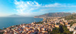 Beautiful panoramic aerial view on the center of Sorrento city, sunset, houses and streets, sea views and a Vizuvius, Napoli in the distance. Travel and vacation concept on Italy. Infrastructure.