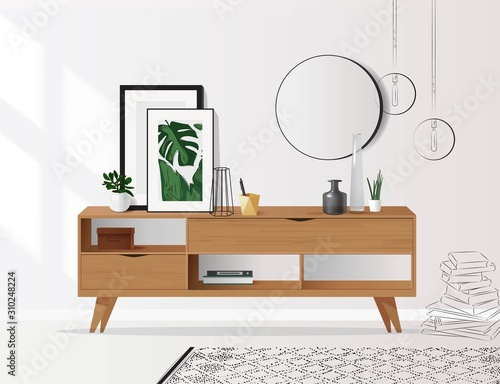 Wooden sideboard with plants and posters on it against white wall Canvas-taulu