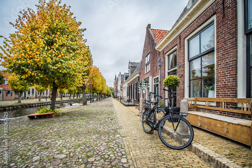 Street scene in the fall of the historic city of Sloten in the Dutch province of Friesland