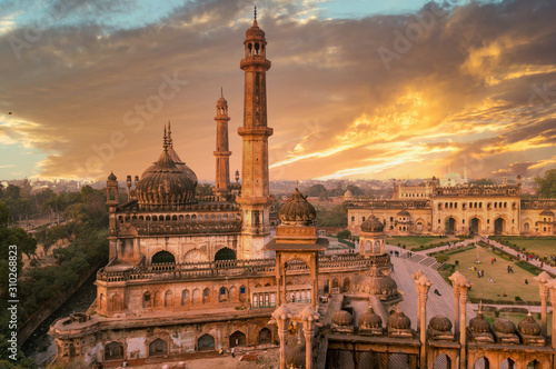 domed roof and towers of Asfi mosque shot at sunset - 310268823