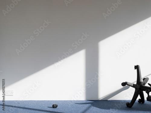 Broken Office Chair Casting Shadow On Wall Wallpaper Mural